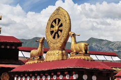 The wheel of dharma and double deer with tibetan flag Stock Photography
