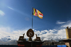 The wheel of dharma and double deer with tibetan flag Stock Photos