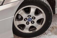 Wheel disk view of Toyota Ipsum last generation in silver color after cleaning before sale in a winter day and snow background. Novosibirsk, Russia - 03.10.2019 royalty free stock photos