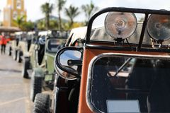 Offroad car in focus and blur cars at back. 4 wheel drive buggy car parked for rent in the port Costa Maya Royalty Free Stock Photo