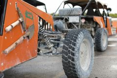 Offroad car in focus and blur cars at back. 4 wheel drive buggy car parked for rent in the port Costa Maya Stock Photo