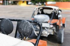 Offroad car in focus and blur cars at back. 4 wheel drive buggy car parked for rent in the port Costa Maya Stock Photos