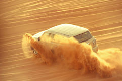 A 4-wheel drive car in action in a desert safari trip in Dubai-UAE on 21 July 2017. The Dubai desert trip in off-road car is major tourists attraction in Dubai Royalty Free Stock Photography