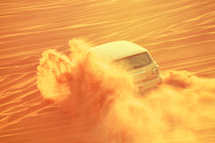 A 4-wheel drive car in action in a desert safari trip in Dubai-UAE on 21 July 2017. The Dubai desert trip in off-road car is major tourists attraction in Dubai Royalty Free Stock Photo