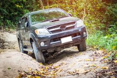 4 wheel drive in the forest. 4 wheel drive is climbing on a difficult off-road in mountain forests in Thailand Stock Photography