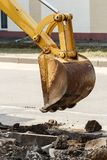 Wheel excavator digging trench on rocky land Royalty Free Stock Images