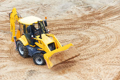Wheel Excavator Loader with backhoe. Yellow Wheel loader Excavator with backhoe loading sand at eathmoving works in construction site, upper view Royalty Free Stock Images