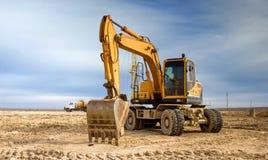 Wheel excavator. Wheel excavator running in the steppe stock photo