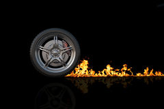 Wheel and fire. Isolated black Stock Photography