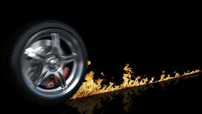 Wheel and fire. On black Stock Photography