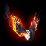 Wheel with fire wings. On black background Royalty Free Stock Images