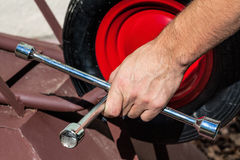 Wheel fixing with a spanner Royalty Free Stock Photography