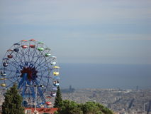 Wheel of fortune. Panoramic image of Barcelona city at the back Stock Photos
