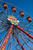 Wheel of fun. Big festival wheel on blue sky Royalty Free Stock Photography