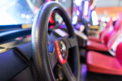 Wheel of a game console racing video game. Slot machines at an arcade Blur background Royalty Free Stock Images