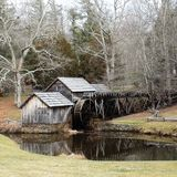 Wheel Generating Clean Energy. Here is a historic site a road side attraction that shows stream of running water generating clean energy royalty free stock photos
