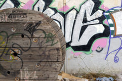 Wheel and graffiti. Hi is a strage composition that I found in a street Royalty Free Stock Photo