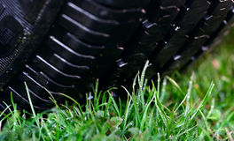 Wheel on the grass Royalty Free Stock Photography