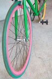Wheel of green fixed gear bicycle. At building Royalty Free Stock Image
