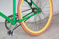 Wheel of green fixed gear bicycle. At building Royalty Free Stock Photography