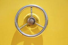 Wheel hatch on yellow vessel door. Wheel hatch on yellow vessel door royalty free stock photography