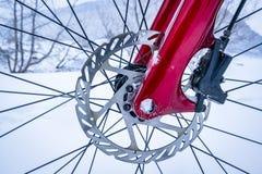 Wheel hub of fat bike with disc brake. Wheel hub of a fat bike with  hydraulic disc brake against winter landscape Royalty Free Stock Image
