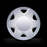 Wheel hubcap rim. Metallic alloy hubcap rim wheel royalty free stock photography
