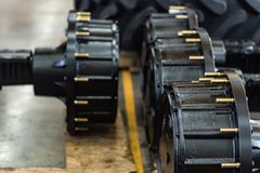 Wheel hubs of new heavy tractor close. Wheel hubs of modern heavy tractor or combine harvester. Selective focus Stock Photo
