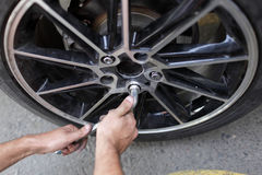 Wheel installation Royalty Free Stock Photos