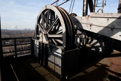 Cable wheel lift crane Landschaftspark, Duisburg, Germany. Wheel at a lift, pulley and cable tower of the old and abandoned iron and steel factory at the royalty free stock photos