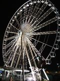 Wheel of light. Giant ferris wheel in Niagara Falls at night Royalty Free Stock Photos
