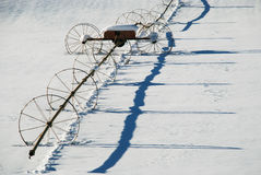 Wheel Line Irrigation. System casts long shadows in snow Royalty Free Stock Photos