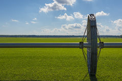 Wheel line irrigation system. On a green field Stock Photos