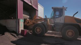 Wheel loader doing his job at concrete blocks factory stock footage
