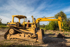 Wheel loader Excavator with caterpillar backhoe Royalty Free Stock Photos