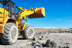 Wheel loader excavator at granite or iron ore opencast mine Stock Images