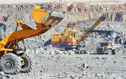Wheel loader excavator at granite or iron ore opencast mine Royalty Free Stock Photography