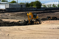Wheel loader Excavator loading soil at eathmoving works. In construction Stock Images
