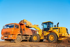 Wheel loader excavator and tipper dumper stock photography