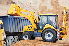 Wheel loader excavator and tipper dumper stock photo