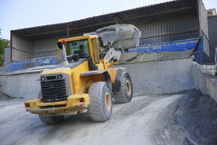 Wheel loader Excavator unloading sand Stock Photo