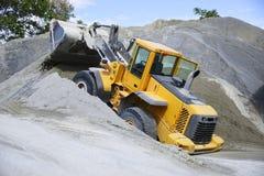 Wheel loader Excavator unloading sand Stock Image