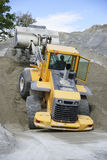 Wheel loader Excavator unloading sand Royalty Free Stock Images