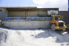Wheel loader Excavator unloading sand Stock Photo