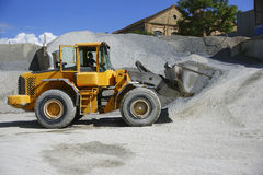 Wheel loader Excavator unloading sand Royalty Free Stock Image