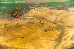 Wheel loader Excavator unloading sand, tractors and dump truck i. Nside construction site Royalty Free Stock Images