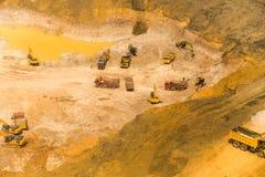 Wheel loader Excavator unloading sand, tractors and dump truck i Stock Image