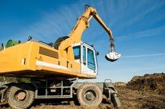 Wheel loader excavator at work stock image
