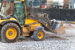 Wheel loader excavator working. With crushed stone royalty free stock images