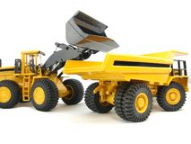 Wheel loader and loading dumper Royalty Free Stock Photo